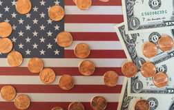 Dollar notes and coins and flag of the United States Royalty Free Stock Photos