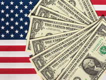 Dollar notes and flag of the United States Royalty Free Stock Images