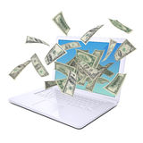 Dollar notes flying around the laptop Royalty Free Stock Images