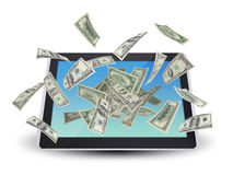 Dollar notes flying around the tablet pc Royalty Free Stock Photos