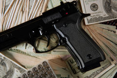 Dollar notes and gun, black pistol Stock Images