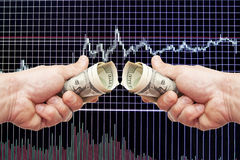 Dollar notes in a hand on a black background with the schedule. Of Japanese candles and indicators stock image