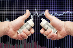 Dollar notes in hands on a black background with the schedule. Of Japanese candles and indicators royalty free stock photography
