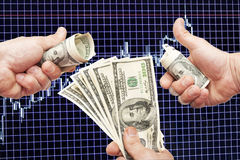 Dollar notes in hands on a blue background with the schedule. Of Japanese candles and indicators royalty free stock photos