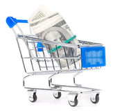 Dollar notes in shopping cart Stock Photo