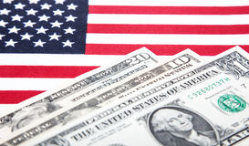 Dollar notes on US flag Royalty Free Stock Photo
