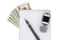 Dollar, Notizblock, Stift und Handy Lizenzfreies Stockbild