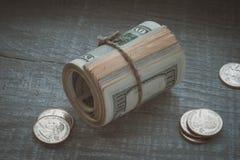 Dollar och cents arkivfoto