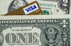 Dollar och ett hörn av visumkortet royaltyfria bilder