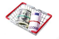 Dollar och euro i en korg Arkivbild
