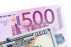 Dollar och euro som isoleras på vit Royaltyfri Foto