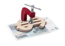 Dollar och euro som klämmas fast i klämma Royaltyfria Foton