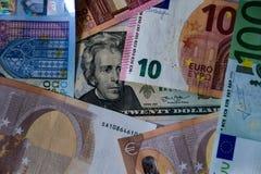 Dollar- och europengarbakgrund gillar begrepp royaltyfria bilder