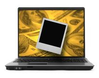 Dollar och foto på bärbar dator Royaltyfri Bild
