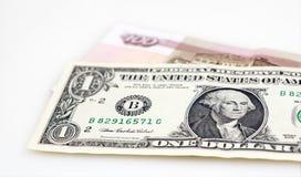 Dollar och hundra rubel sedel Arkivbilder