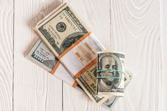 Dollar och pengarrulle Fotografering för Bildbyråer