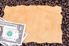 Dollar and old paper on coffee beans Stock Photos