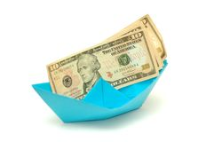 Dollar on origami boat Royalty Free Stock Photography