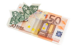 Dollar origami butterfly sits on 50 euro banknote Royalty Free Stock Photo