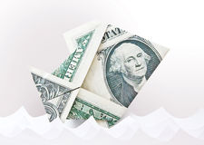 Dollar origami fish in paper waves. Moneygami background. Stock Image