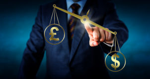 Dollar Is Outbalancing The British Pound Sterling Royalty Free Stock Photography