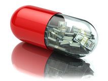 Dollar packs in the capsule, pill. Healthcare costs or financial Royalty Free Stock Image