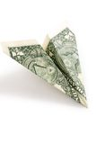 Dollar paper airplane Royalty Free Stock Image