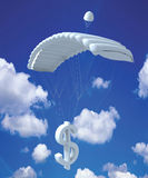 Dollar Parachute. Dollar symbol attached to a parachute descending down the sky Stock Photos