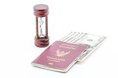 Dollar, passport and hourglass. Stock Photo