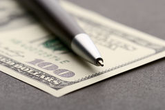 Dollar and pen stock photography