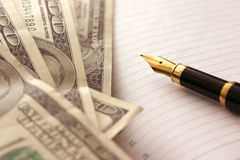 dollar penna royaltyfri foto