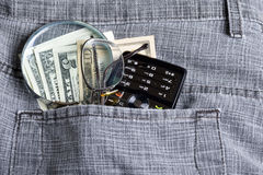 Dollar with phone in pocket Stock Photo