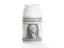 Dollar on pills container, cost of medical health care Stock Photos