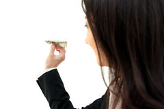 Dollar plane. Young business woman holding dollar plane in hands isolated on white background Royalty Free Stock Image