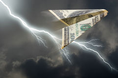 Dollar plane. Business concept. Dollar plane and  thunderstorm Royalty Free Stock Photos
