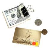 Dollar, plast- kort och cent royaltyfri fotografi
