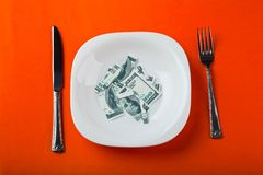Dollar on plate. With fork and knife Royalty Free Stock Photo