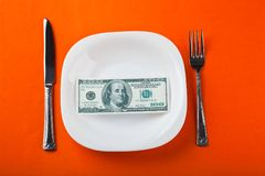 Dollar on plate. With fork and knife Royalty Free Stock Photography