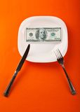 Dollar on plate. With fork and knife Stock Photos
