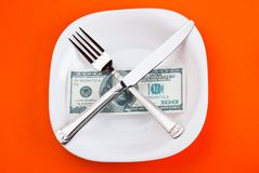 Dollar on plate. With fork and knife Stock Images