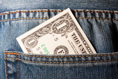 Dollar in pocket. Concept of poor>, one US dollar in a jeans pocket Stock Images