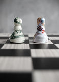 Dollar pound currency chess. Dollar and british pound money chess pieces Royalty Free Stock Photos