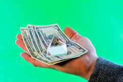 Dollar through the prism of. Abstraction, man holds in the palm of dollars and they have a glass prism stock photos