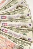 dollar pund royaltyfria bilder