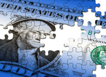 Dollar puzzle. Jigsaw puzzle pattern applied to US Dollar note royalty free stock photos