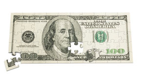 100 dollar puzzle. $100 bill puzzle with two pieces moved on a white background Stock Photo
