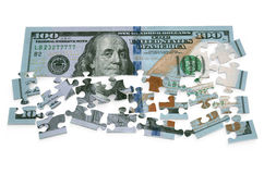 100 dollar puzzle. Isolated on white background Royalty Free Stock Photography