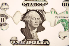 Dollar and puzzle pieces. One dollar U.S. banknote and puzzle pieces Stock Photos