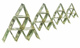 Dollar pyramid. Four pyramids made out of one hundred dollar bills Royalty Free Stock Image