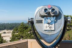 Dollar quarter binoculars at a high point of view over the Oregon dunes. stock images